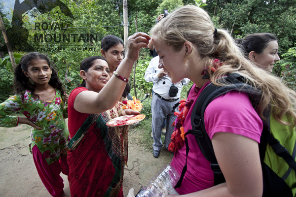 Traditional welcome before entering the homestay.