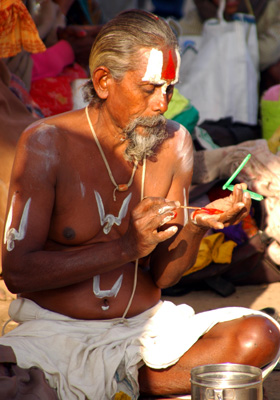 A sadhu getting ready for the festival.