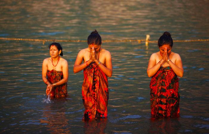 Devotees performing holy bath. AP