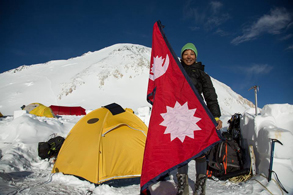 Susmita Maskey at Mt. Denali with her national flag.