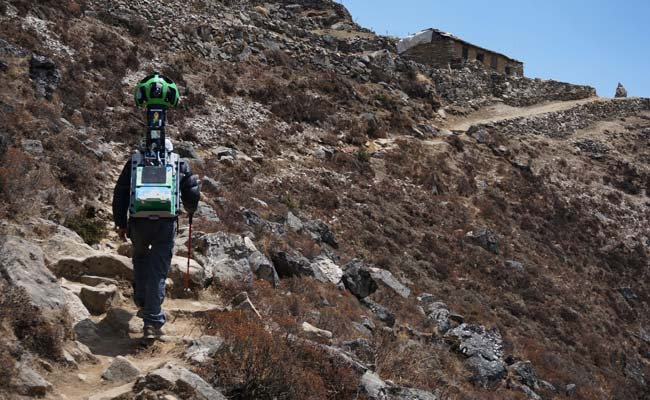 A memeber of the Google Street View project walks with the camera used to capture project footage through Nepal's Khumbu region in April last year. Google on March 12, 2015 launched a virtual tour of Nepal's rugged Everest region. (AFP)